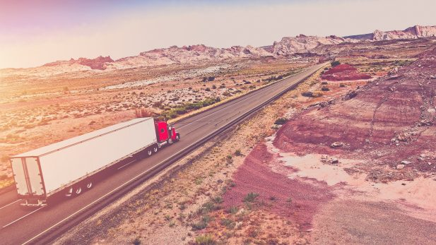Truck Transport Concept. Semi Truck on the American Desert Highway.