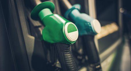 Gasoline Pump Nozzles Closeup Photo. Gas Station Equipment. Car Refuel Concept
